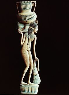 A cosmetic spoon in the form of a naked young woman carrying an amphora on her shoulder and a bunch of lotus flowers. She wears a broad collar, a wig and a tiny waistband. Now in the Louvre. Ancient Egypt Civilization, Ancient Egypt Art, Old Egypt, Ancient Artifacts, Ancient Civilizations, Ancient History, Pyramids Egypt, Egyptians, Women's History