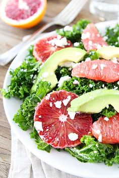 Kale Salad with Citrus, Avocado, and Feta Cheese on http://twopeasandtheirpod.com Love this healthy and refreshing salad!