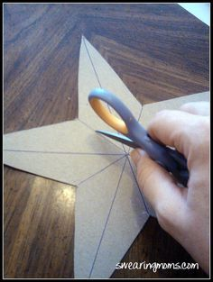 Cardboard star covered in burlap~ These would be nice using the pretty sparkly cardboard from Michael's!  :)