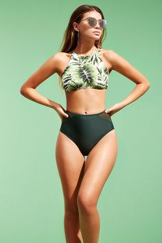 A pair of knit bikini bottoms featuring a high-waisted fit and sheer mesh panels. Matching bikini top available.