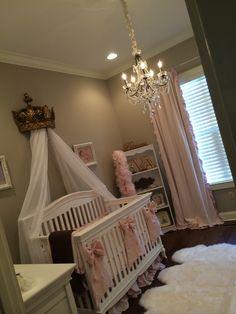 Eva's elegant nursery with a sheepskin rug, Restoration Hardware linens and drapery, and 3 crib dupioni silk bows from Caty's Cribs on Etsy. Baby girl nursery.