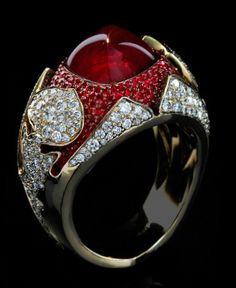 """Mousson Atelier Hi Jewellery Collection """"""""1000&1 Night"""""""" Gold 750 Ruby and Diamond Ring featuring 1 Ruby totaling 6.42ct, 197 Rubies totaling 1.08ct and 215 Diamonds totaling 1.76ct; 18.18g total wight"""