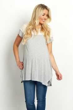 A little lace never hurt anyone, and it certainly makes this maternity top more than your average short sleeve. A soft lightweight fabric combines with a ruffled, lace accent for a feminine top for everyday casual wear. Style this maternity top with your favorite jeans and flats for a complete look.