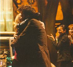 """The last real hug between the Doctor and Rose, which you can't really see very well in """"Journey's End."""""""