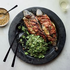 Pancetta-Wrapped Trout with Sage and Lemon | TV chef Andrew Zimmern's grilled trout gets a flavor boost from pancetta, sage and lemon. Find the recipe at Food & Wine.