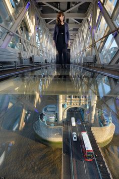 Long way down: The glass floor panels weigh over 1,000 pounds each and required a 20-strong team to install