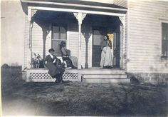 Morris Farm, Brookings, SD, date unknown  Elsie Edna Williams-Dollins is sitting on the front porch, she is the wife of Edgar Gaylon Dollins, and daughter in law to Anna Pearl Morris (Pearl Dollins) who married Marion Columbus Dollins.  Pearl's father is Joseph Greene Morris, son of Richard Harvey Morris, and Margaret RoAnna Duke, daughter of William Duke and Peggy Cary.