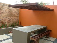 exterior feature wall with slat shade and cement table