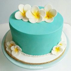 Decided to go with a turquoise frangipani styled theme for my wedding and this… (hawaiian luau food wedding cakes)