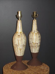 """""""Rebels with a Cause"""": pair of decorator white, with cocoa brown and mustard detail, gold glitter.21""""H."""