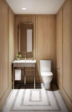 Warm wood walls with millwork, brass sink fixture and geometric inlayed marble floors. Gorgeous, modern, minimal and sophisticated bathroom design idea.:
