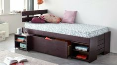 small bed with storage drawers and casters for kid's bedroom
