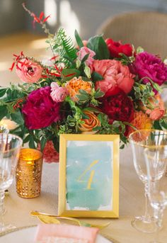Bright peony bouquet and watercolor number sign: http://www.stylemepretty.com/connecticut-weddings/stonington/2015/02/06/preppy-wedding-inspiration/ | Photography: Kat Harris - http://www.katharrisweddings.com/