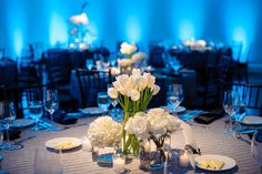 Sleek contemporary reception decor featuring tulips, hydrangeas, and roses  #NewberryBros #Denver #Wedding