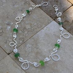 Octopus necklace with green sea glass