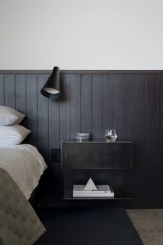 Love this dark stained tongue and groove/ships lap detail in this bedroom
