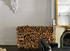 love firewood stored indoors- adds an interesting architectural element