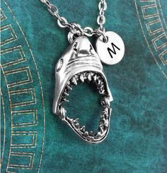 Extra cool points for this jaw shark necklace with an initial charm — $16.95 | 23 Shark-Inspired Jewelry Pieces You Absolutely Need Right Now