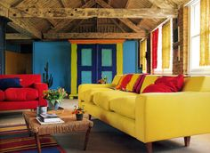 This rustic living room from Tricia Guild's book In Town shows how you can mix rustic with lots of color.