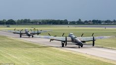 On the tarmac: The world's only two airworthy Lancaster bombers were united on a windswept...
