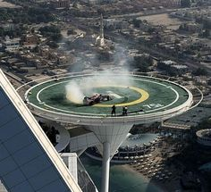 Ever seen a Formula 1 car doing doughnuts on the famous Burj Al Arab hotel's helipad 210 meters high?? Check out the video by hitting the link... #wow #RedBull #PleaseDontFall