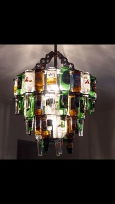 The beer bottle chandelier is the ultimate lighting source for a home bar or enclosed patio. Made from real beer bottles, the beer bottle chandelier is a beautiful source of light that displays many colors and makes a great house warming gift. Beer Bottle Chandelier, Beer Bottle Lights, Recycled Bottle Crafts, Beer Bottle Crafts, Recycled Glass, Recycled Art, Craft Beer, Beer Crafts, Empty Bottles