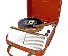 a leather cased portable record player. Why are things this cool anymore?
