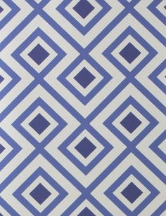 La Fiorentina Wallpaper A geometric wallpaper designed by David Hicks featuring a large diamond shaped design printed in indigo and blue on a white background.