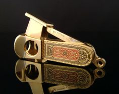 Vintage PFEILRING SOLINGEN pocket cigar cutter with gold plated details. A rare and unique item. In excellent condition. The cigar cutter has