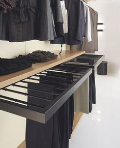 To make the most possible use in a small space, incorporate storage that frees up available space. For example, a pull-out trouser rack can be mounted on the lower level for easy access.