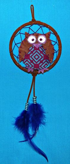 My first attempt at selling a dream catcher via the internet from my sister's shop at http://www.etsy.com/listing/164956236/owl-dreamcatcher
