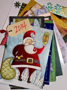 bind your Christmas cards with an office ring and a tag stating the year - so easy! live. love. scrap.