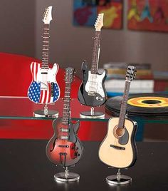 This Miniature Replica Guitar lets you collect and display some of the coolest models ever made. The small-scale version of your favorite guitar is loaded with tiny details for an authentic look. Comes with a carrying case and metal stand for display. Ap