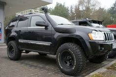 Toyota 100 Series (I think) snorkel on a WK. Think I'm gonna try it with a cheap Ebay version.