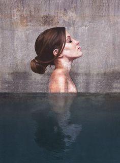 Des portraits peints grâce au stand-up paddle émergent littéralement de l'eau