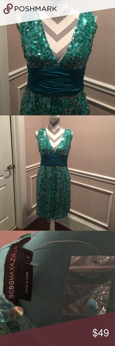 """NEW GORGEOUS GREEN SEQUIN DRESS W/DARK GREEN SASH Can't begin to say how beautiful this dress is. Perfect for that formal or semi formal get together. The color green that makes up this dress is between a sage & dark green. But not as dark as the sash. The sash is a much darker green giving the dress such beautiful contrast. The dress measures 38"""" from shoulder to dress bottom. Hits a person that's 5'6"""" just above the knee. Also, since it is new it comes with a small bag of sequins…"""