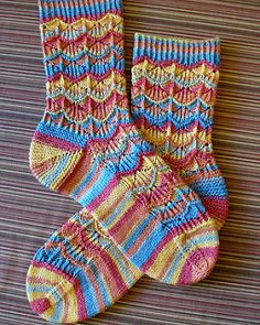 """Margaritaville pattern by Adrienne Fong """"Gentle tropical breezes, ocean waves lapping onto the shore, seashell studded beaches, refreshing umbrella drinks, and more await you here in """"Margaritaville! Wool Socks, My Socks, Knitting Socks, Free Knitting, Knitting Patterns, Crochet Patterns, Knitted Bags, Knit Or Crochet, Ocean Waves"""