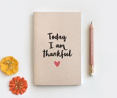 The original Today I am Thankful Journal available in brown or white cover from Happy Dappy Bits.  I am thankful — a wonderful Autumn inspired Notebook & Pencil Set, printed on brown 100% recycled post consumer cardstock. Flowy type in black with a heart underneath in coral. Perfect motivation and reflection for all the things you are thankful for. Now available with Personalization.  **Available in MINI, LARGE or MIDORI (regular) sizes with blank, lined/ruled or dot grid inside pages —…