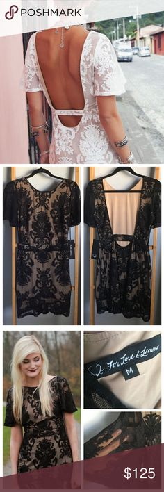 FOR LOVE & LEMONS San Marcos Black Lace Mini Dress SOLD OUT.  Delicate floral lace over beige lining, short bell sleeves and an alluring open back. The banded waist adds shape in just the right places, while the fluted skirt adds even more feminine flare below. Hidden side zipper. Lined. 40% Polyamide, 40% Cotton, 20% Polyester. Lining: 87% Polyester, 13% Spandex. Dry Clean Only. Photos are of actual dress but please note the pictures of the models are not mine. Used only for style shot…