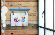 personalized hangers to display children's art. craft, kids artwork, kid artwork, display children, display art, children artwork, child art, hanger display, camp art