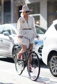 Catherine Baba Biking the Catherine Baba way means wearing a dangerously short dress with impractical wedges and a crazy sun hat. Which is to say, she looks absolutely fabulous.  Photo: YoungJun Koo/I'M KOO
