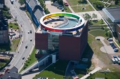 oliafur eliasson's 'your rainbow panorama' hovers as a luminous circle on the museum roof