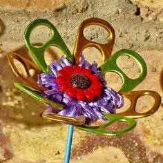 Flowers from upcycled materials ~ 1 of 4 photos by Urban Woodswalker, via Flickr