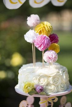 Girlie Cake: A rosette-covered cake got an added dose of cuteness with pom toppers. Source: Parties on a Pedestal