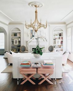 Pulling furniture into the center, away from walls and creating an intimate cluster; perfect for conversations and relaxing. A small touch of an unexpected color, shown in the benches.