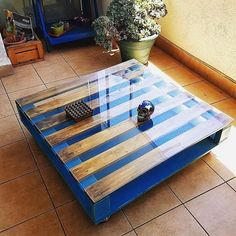 TV launch is the main area in every home, so let us start with the furnishing of it and here you can see the reclaimed wood pallet table with the glass top; which is a good idea for those who don't have kids in the home because having kids increases the chances of glass damage.