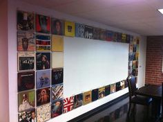 Funky ways to make offices interesting.  This is a vinyl record cover border with dry erase paint in the middle as whiteboard.  Tres cool.