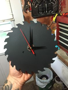 Saw blade clock ,, bought the clock from dollar store and had a little bit of ultra mat spray paint left