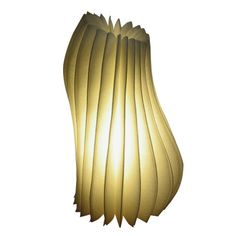 Simply elegant with a naturally moving flow. Reinvent your home with this Spring-inspired Stola Table Lamp!