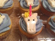 Unicorn Cupcakes - Vanilla cupcakes with purple buttercream, Fondant unicorns with birthday candle horns and pearl dust, and cake sparkles